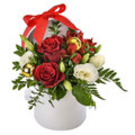 Joy.    Festive Arrangement of Roses and Lovely Blooms in a white hat box.